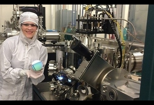 Victoria Rosborough working in a cleanroom where device processing is performed.