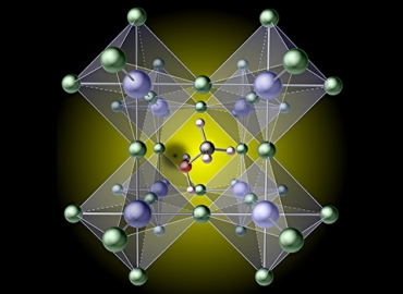 Artist's concept illustration depicts a hydrogen vacancy (the black spot left of center) created by removing hydrogen from a methylammonium molecule, which traps carriers in the prototypical hybrid perovskite, mehtylammonium lead iodide CH3NH3Pbl3. Illustration by Xie Zhang