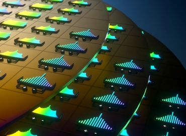 Artist's concept illustration depicting soliton microcombs on silicon wafers. Illustration by Brian Long