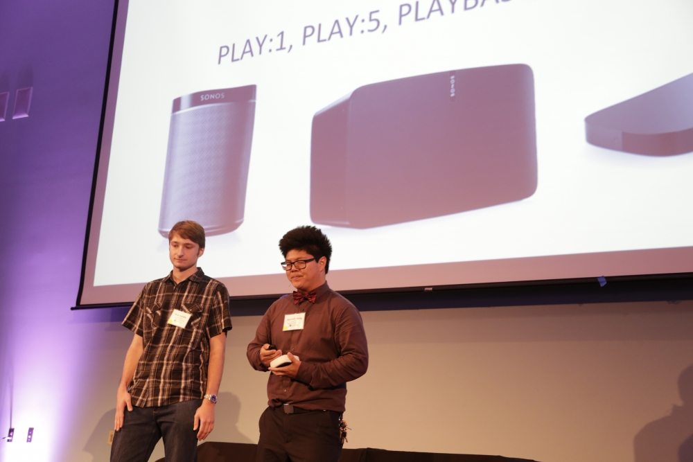 Members of SONOS COM present their project on stage