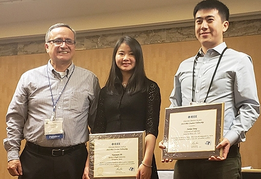 Junkai Jiang receives his award from IEEE EDS president D. Fernando Guarin, along with fellow recipient Yuanyuan Shi, a doctoral student in Spain.