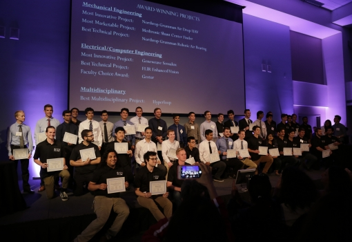 Proud students receive their certificates of completion of the capstone program.