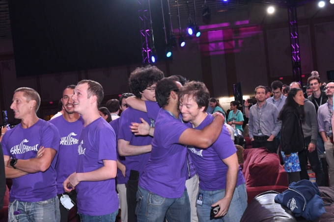 Members of Team Shellphish celebrate the announcement of their victory